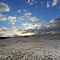 写真: 薄雪の朝日